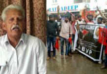 ABVP activists protest in front of revolutionary writer Varavara Rao house in Hyderabad condemning Araku MLA murder