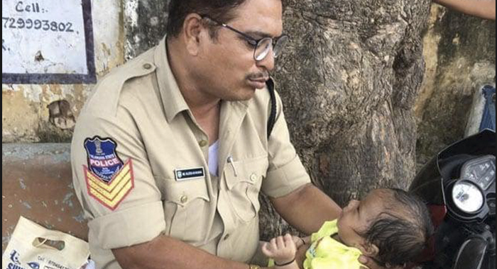 Mother Writting Exam.. The constable who sees the baby