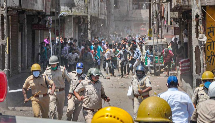 Migrant Workers Clash with Police in Surat