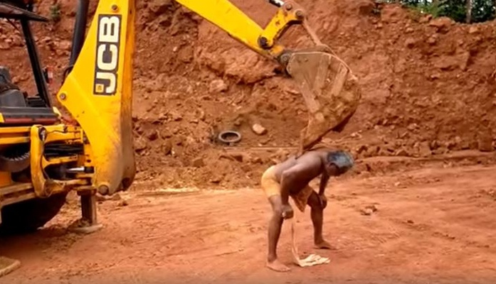 Man itch relief using jcb loader kerala